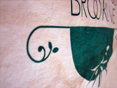 A side view of the Bountiful Brookline t-shirt - nice curly cue!